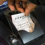 Scott Olson, Getty Images A lottery ticket is printed for a customer at a Chicago 7-Eleven. CHICAGO, IL - FEBRUARY 11: A Powerball lottery ticket is printed for a customer at a 7-Eleven store on February 11, 2015 in Chicago, Illinois. Ticket sales have caused the jackpot to grow $500 million, one of the largest in the game's history. (Photo by Scott Olson/Getty Images) ORG XMIT: 537354205 ORIG FILE ID: 463217092