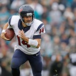 Ryan Fitzpatrick, shown here playing for the Houston Texans on Dec. 7, 2014, moved into the starting quarterback spot for the New York Jets after Geno Smith was sidelined with a broken jaw.