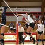 Lourdes' Ellie DeGroot spikes the ball in a match against Markesan Tuesday.