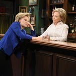 """APKate McKinnon, left, portraying Hillary Rodham Clinton, and Hillary Rodham Clinton, right, portraying Val, appear during the """"Bar Talk"""" sketch on """"Saturday Night Live,"""" in New York. In this Saturday, Oct. 3, 2015, photo, provided by NBC, Kate McKinnon, left, portraying Hillary Rodham Clinton, and Hillary Rodham Clinton, right, portraying Val, appear during the """"Bar Talk"""" sketch on """"Saturday Night Live,"""" in New York. (Dana Edelson/NBC via AP)"""