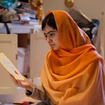 "This Dec. 17, 2013 photo provided by Fox Searchlight Pictures shows, Malala Yousafzai in Birmingham, England. Yousafzai is the subject of the documentary film, ""He Named Me Malala."" (Caroline Furneaux/Fox Searchlight Pictures via AP)"