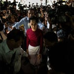 Aung San Suu Kyi, the Nobel Peace Prize winner and leader of Burma's opposition party, arrives at a polling station in Rangoon on Nov. 8, 2015, to cast her vote during the country's first democratic election in 25 years.