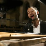 """This Oct. 28, 2015 photo provided by A+E Networks shows John Legend performing as part of the """"Shining A Light: A Concert for Progress on Race in America,"""" in Ferguson, Mo. The two-hour special event will air across the entire A+E Networks portfolio, including A&E, HISTORY, Lifetime, H2, LMN and FYI, as well as on iHeartMedia broadcast radio stations nationwide and the iHeartRadio digital platform on Friday, Nov. 20, at 8 p.m. ET/PT. (Mark Hill/A+E Networks via AP)"""