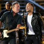Bruce Springsteen, left, and John Legend perform at Shining a Light: A Concert for Progress on Race in America at the Shrine Auditorium on Wednesday.