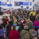 Invision for Wal-Mart Customers shop during Wal-Mart?s Black Friday event at 6p.m. Thanksgiving night 2014 in Bentonville, Ark. This year Walmart is getting rid of multiple deal events throughout Black Friday weekend in favor of offering all deals at once. Customers shop during Walmart's first Black Friday event at 6 p.m. Thanksgiving night, Thursday, Nov. 27, 2014 in Bentonville, Ark. This year Walmart is getting rid of multiple deal events throughout Black Friday weekend in favor of offering all deals at once.