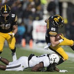 Iowa's Matt Vandeberg carries the ball as he is tackled by Purdue's Leroy Clark during the Iowa vs. Purdue game at Kinnick Stadium in Iowa City, Saturday, Nov. 21, 2015.