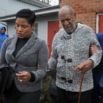 Actor and comedian Bill Cosby is helped as he leaves after a court appearance Wednesday in Elkins Park, Pa. Cosby was arrested and charged with drugging and sexually assaulting a woman at his home in January 2004.