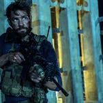 """Christian Black/Paramount Pictures/APIn this photo provided by Paramount Pictures shows John Krasinski as Jack Silva in the film, """"13 Hours: The Secret Soldiers of Benghazi"""" from Paramount Pictures and 3 Arts Entertainment/Bay Films. In this photo provided by Paramount Pictures shows John Krasinski as Jack Silva in the film, """"13 Hours: The Secret Soldiers of Benghazi"""" from Paramount Pictures and 3 Arts Entertainment/Bay Films. The movie releases in U.S. theaters Jan. 15, 2016. (Christian Black/Paramount Pictures via AP)"""