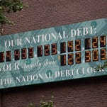 The National Debt Clock sat at $14.5 trillion in August 2011. As of Sunday, it was at more than $18.9 trillion and counting.