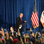 Donald Trump walks onto the stage to speak during a campaign event at the University of Iowa on Jan. 26, 2016, in Iowa City.