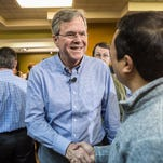 HIAWATHA, IA - JANUARY 31: Republican presidential candidate Jeb Bush (C) greets audience members following a campaign event at his local field office on January 31, 2016 in Hiawatha, Iowa. The Democratic and Republican Iowa Caucuses, the first step in nominating a presidential candidate from each party, will take place on February 1. (Photo by Brendan Hoffman/Getty Images)