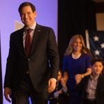 Senator Marco Rubio arrives with his family at his campaign party in the Iowa Ballroom at the Marriott in downtown Des Moines, Monday, Feb. 1, 2016.