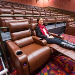 Madelyn Rybczyk demonstrates the reclining seats at Cinemark Altoona and XD movie theaters at 2227 Adventureland Drive opening this week, shown here Monday Feb. 8, 2016. Twelve theaters of various sizes but all with reclining leather seats.