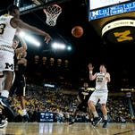 Feb 13, 2016; Ann Arbor, MI, USA; Michigan Wolverines guard Caris LeVert (23) passes the ball to forward Ricky Doyle (32) in the first half against the Purdue Boilermakers at Crisler Center. Mandatory Credit: Rick Osentoski-USA TODAY Sports