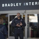 Fliers see bigger security presence at U.S. airports