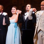 "In this file photo, Leslie Odom Jr., from left, Phillipa Soo, Lin-Manuel Miranda and Christopher Jackson appear at the curtain call following the opening night performance of ""Hamilton"" at the Richard Rodgers Theatre in New York.  (Photo by Charles Sykes/Invision/AP, File)"