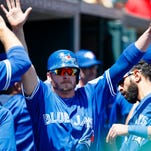 Blue Jays' Josh Donaldson receives congratulations from teammates after scoring in the fifth inning.