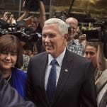 Indiana Gov. Mike Pence, center, and his wife Karen, left, leave after a meeting with Republican presidential candidate Donald Trump at Trump Tower in New York, Friday, July 15, 2016. Trump has chosen Pence as his running mate, adding political experience and conservative bona fides to his Republican presidential ticket. (AP Photo/Andres Kudacki)