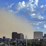 A dust storm encroaches on downtown Sunday, Aug. 21, 2016 in Phoenix,  Ariz.