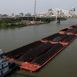 A barge carries coal on the Ohio River last June.