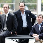 The leaders of Buckingham Properties are from left, Kenneth Glazer, Daniel Goldstein and Rick Glazer. They were photographed in the winter garden of the B&L Building which they own.
