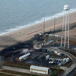 This photo provided by NASA shows an aerial view of the Wallops Island launch facilities on Wednesday, Oct. 29, 2014, following the failed launch attempt of Orbital Science Corp.'s Antares rocket on Oct. 28 in Wallops Island, Va. (AP Photo/NASA, Terry Zaperach)
