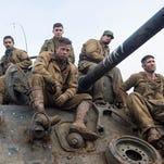 "Don ""Wardaddy"" Collier (Brad Pitt, centered) and his men Boyd Swan (Shia LaBeouf), Norman Ellison (Logan Lerman), Trini Garcia (Michael Peña) and Grady Travis (Jon Bernthal) in ""Fury."""