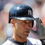 DETROIT, MI - AUGUST 28:  Derek Jeter #2 of the New York Yankees tips his cap to the Tigers bench during the first inning of the game against the Detroit Tigers at Comerica Park on August 28, 2014 in Detroit, Michigan. The Tigers defeated the Yankees 3-2.  (Photo by Leon Halip/Getty Images)