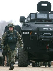 A law-enforcement official walks out of an armored