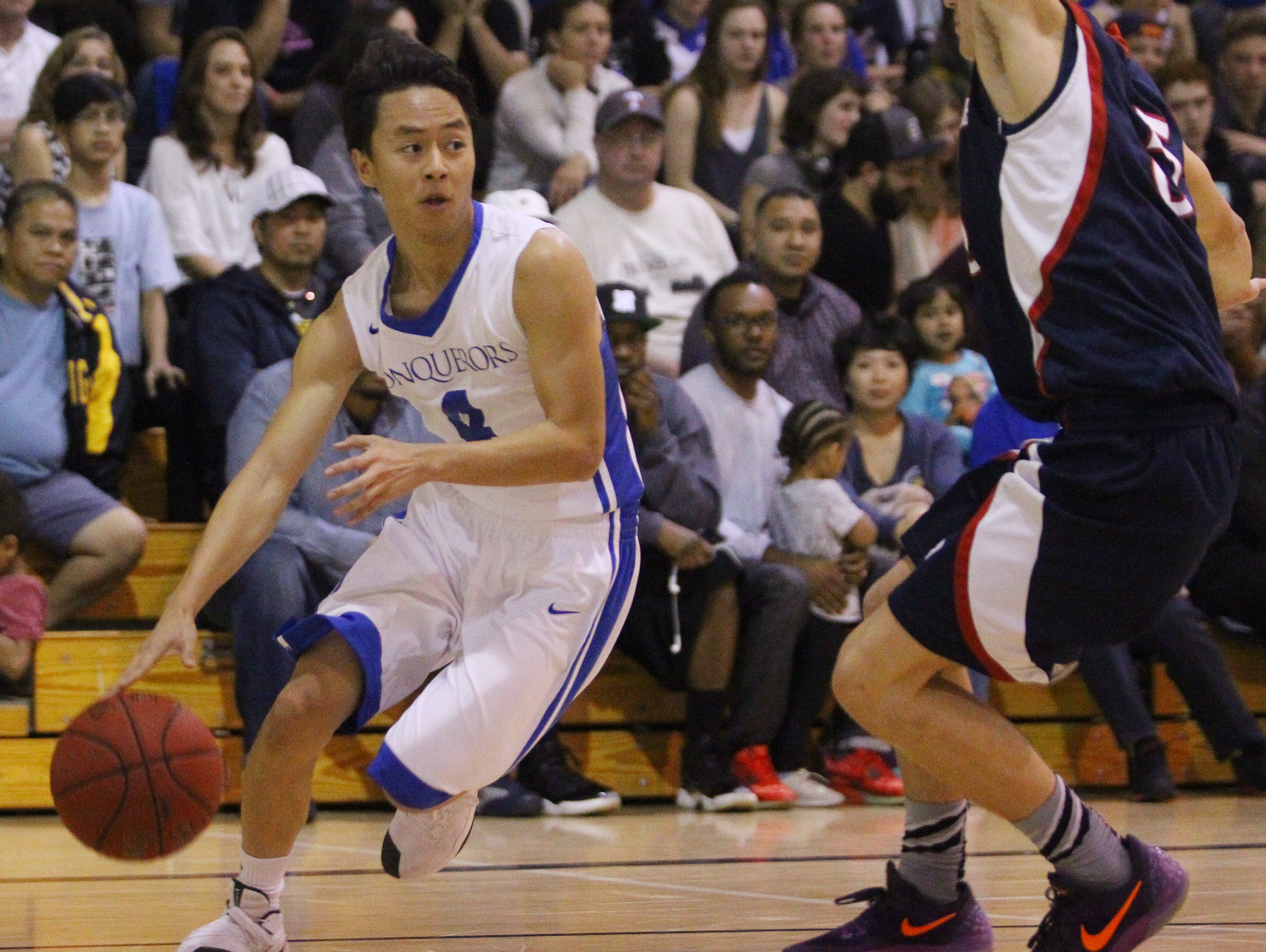 Desert Christian Academy's Kelvin Wong brings the ball up court against Providence High School (Santa Barbara) at Bermuda Dunes on February 21, 2017. DCA advances in CIF playoffs.