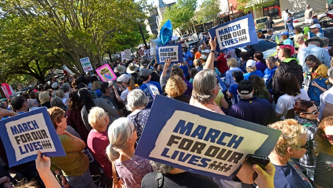 Demonstrators listen to speakers speak at MLK Plaza Saturday, March 24, 2018 during the March for Our Lives demonstration in downtown Pensacola.