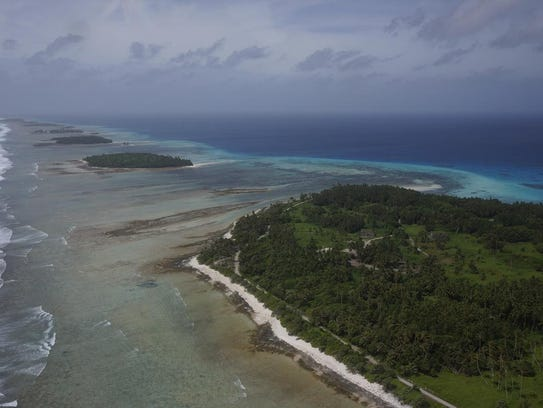 Aerial photograph of Kwajalein Atoll showing its low-lying