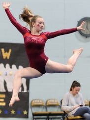 VU's Tali Giubardo shows picture perfect form during the 2017 Gymnastics state championships at Essex High School.