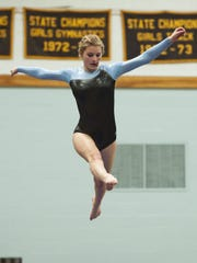 South Burlington's Amelia Pape competes in the beam