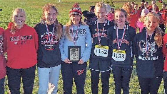 Williamsburg's state championship 8th grade girls XC team, left to right: Regan Grimm, Ruth Jennings, Kendra Eichhorn, Taylor Winegarden, Maiha Richardson, Regan Sandersfeld, Ally Garringer, Nora Slevinski.