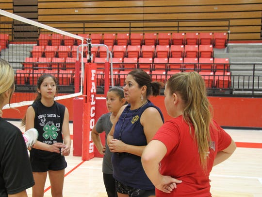 Loving's new volleyball coach, Raquel Chacon, talks to members of her team after Thursday's practice.