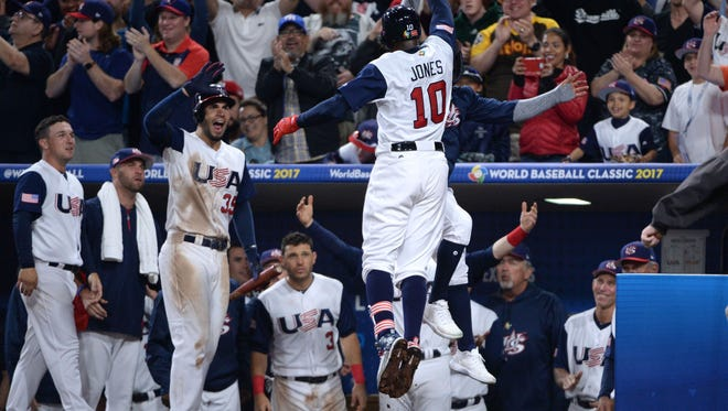 Adam Jones celebrates his game-tying home run with teammates during Team USA's 4-2 win over Venezuela in the World Baseball Classic at Petco Park in San Diego.
