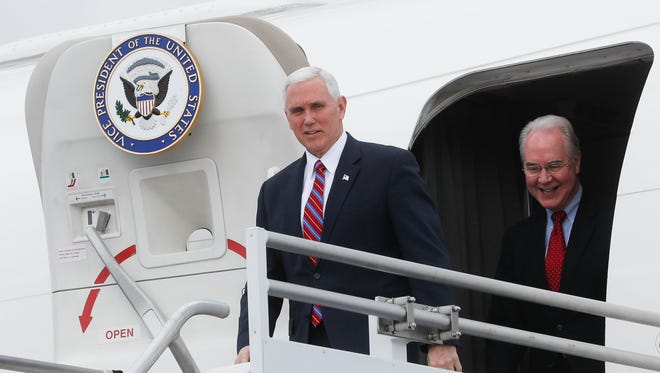 """Vice President Mike Pence, left, and Health and Human Services Secretary Tom Price arrive at Cincinnati/Northern Kentucky International Airport, Thursday, March 2, 2017, in Burlington, Ky. Pence visited Ohio to discuss healthcare and other issues while engaging in a """"listening session"""" with small business owners"""