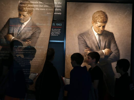 People tour an exhibit dedicated to President John F. Kennedy at the Newseum on Nov. 22, 2013 in Washington.