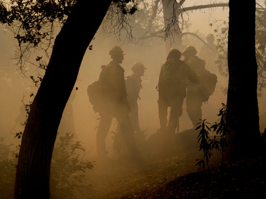 Firefighters from Kern County, Calif., work to put
