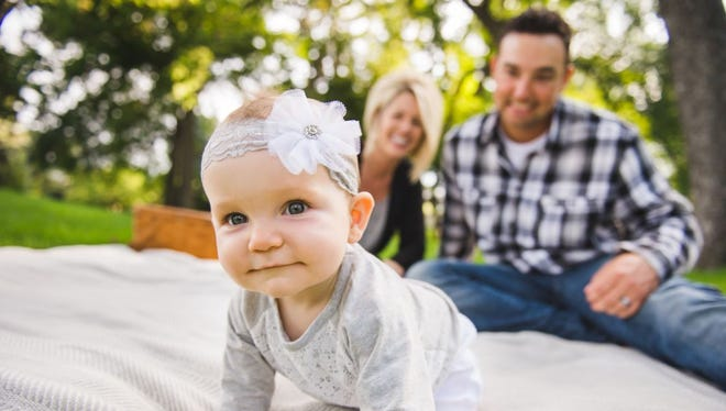 Janae Hull and her husband, Alex, marvel at their daughter, Kylie. In the final minutes of Janae's otherwise uncomplicated 26-hour labor, a major complication arose. Her certified nurse midwife and OB/Gyn physician teamed up to support mother and baby through the delivery at Medical Center of the Rockies in Loveland.