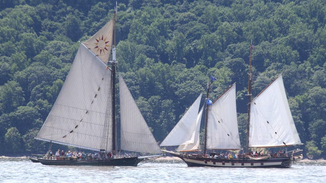 The sloop Clearwater, left, and the schooner Mystic Whaler carry visitors at Clearwater's Great Hudson River Revival at Croton Point Park in Croton-on-Hudson on Saturday.