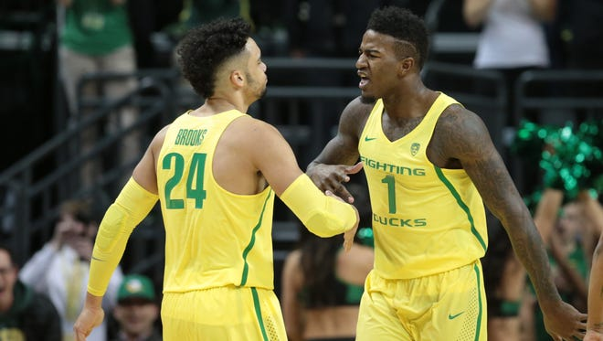 Jan 14, 2017; Eugene, OR, USA; Oregon Ducks forward Dillon Brooks (24) celebrates with forward Jordan Bell (1) against the Oregon State Beavers in the first half at Matthew Knight Arena. Mandatory Credit: Scott Olmos-USA TODAY Sports