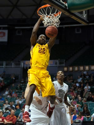 Iowa State Cyclones forward Dustin Hogue (22) makes a dunk over Akron during the first half of the NCAA basketball game at Stan Sheriff Center.