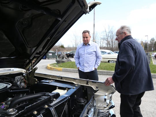 From left, Americo Cascella of Hermosa Beach, California gets some tips form Frank Nicodemas, owner of Castle Cadillac Classics and Antiques in Wappingers Falls, about his newly restored 1963 Cadillac Fleetwood at on April 20, 2018. Cascella is driving the car back to California.