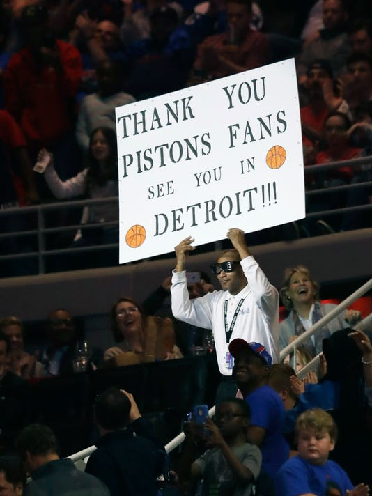 Detroit Pistons dancing usher Shannon Sailes holds up a sign thanking Pistons fans in the second half of an NBA basketball game against the Washington Wizards, Monday, April 10, 2017, in Auburn Hills, Mich. The game tonight was the last Pistons game at the Palace before moving to downtown Detroit next season. (AP Photo/Carlos Osorio)