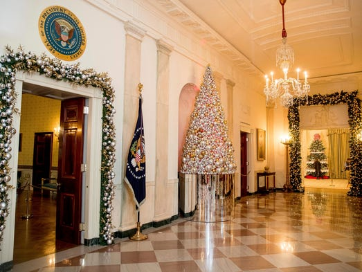 The Cross Hall is decorated at the White House during