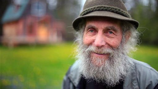 FILE- In May 23, 2014, file photo, Burt Shavitz poses for a photo on his property in Parkman, Maine. Shavitz, a former beekeeper, is the Burt behind Burt's Bees. A spokeswoman for Burt's Bees said Shavtiz died Sunday, July 5, 2015, at his home in rural Maine. He was 80. (AP Photo/Robert F. Bukaty, File)