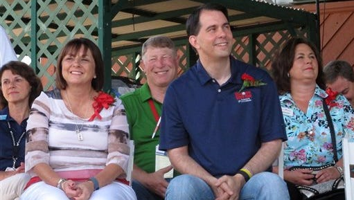Republican presidential candidate, Wisconsin Gov. Scott Walker, and his wife Tonette, attend the opening ceremony of the Wisconsin State Fair, Thursday, Aug. 6, 2015, in West Allis, Wis., before leaving to participate in the Republican presidential debate in Cleveland.