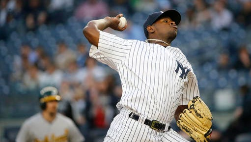 New York Yankees starting pitcher Luis Severino delivers in the first inning of a baseball game against the Oakland Athletics in New York, Thursday, April 21, 2016. (AP Photo/Kathy Willens)